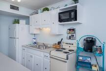 Full kitchen with pots, pans, dishes, silverware, etc. You will also find basic oils and seasoning and most guests leave behind some unused non-perishables for future guests!