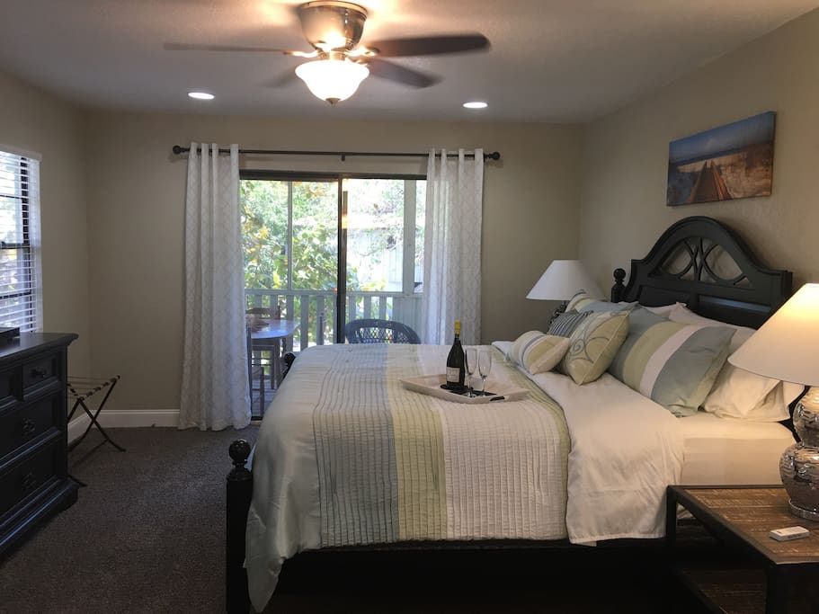Master bedroom with sliding door to the balcony. King bed, brand new mattress and furniture.