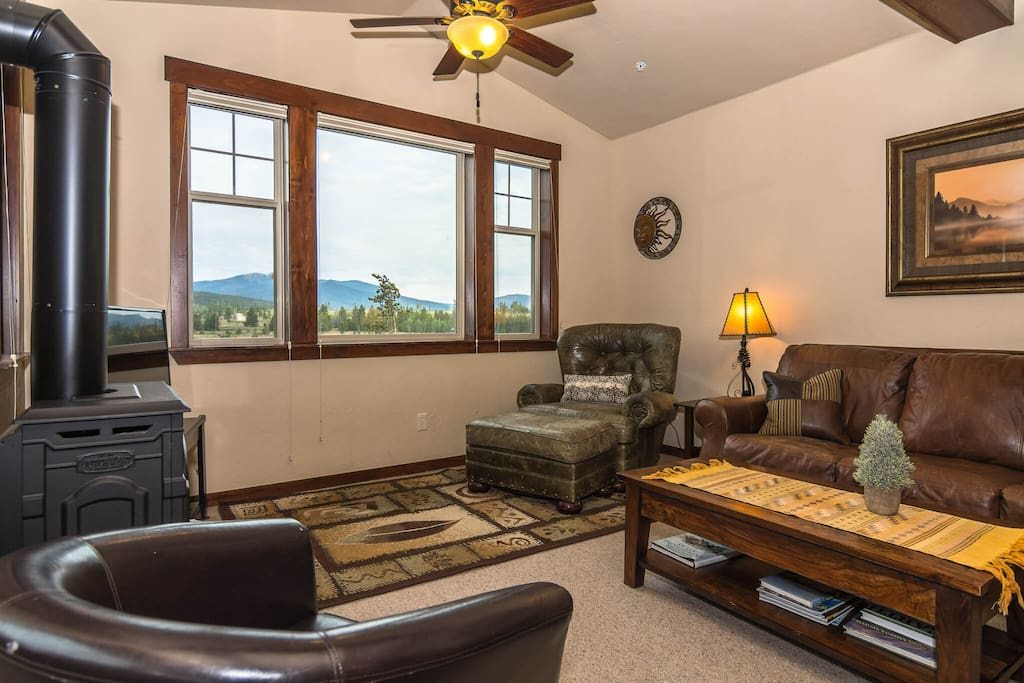 Gas fireplace, flat screen TV and cozy furniture.