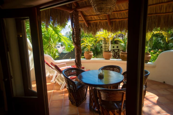 The private patio of studio casita #5 has french doors that open to the interior for indoor-outdoor living.