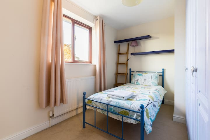 Bedroom 3 (11' x 8') Single bed, hanging space, shelving, lamp  and room for further single mattress (provided) if required for larger parties.