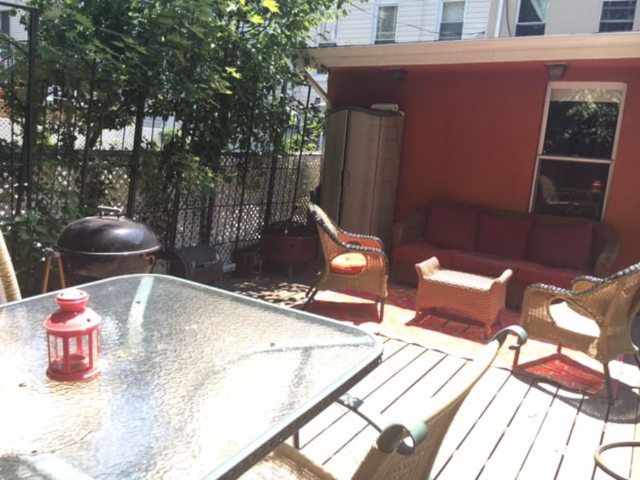 Garden has separate living area with couch and chairs.