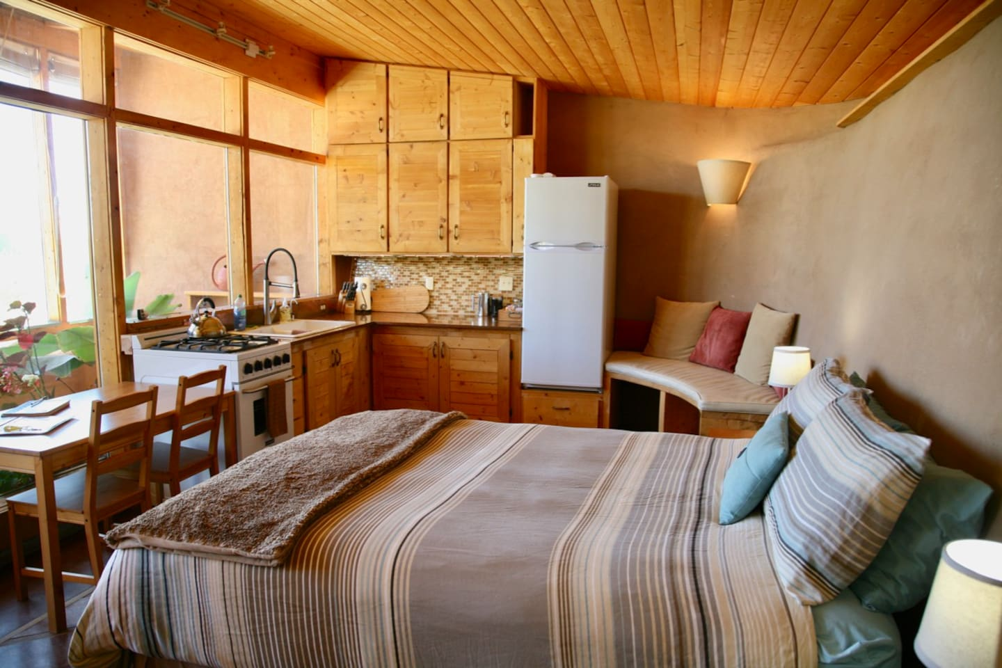 Welcome to our brand new Earthship Tiny Home!   Off-the-grid with all the comforts.