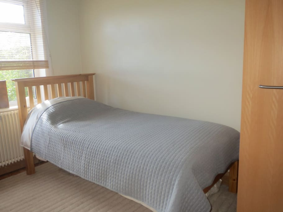 pic shows bed and wardrobe alongside