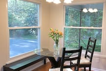 Enjoy breakfast in the light-filled dining area surrounded by azaleas and rhododendrons