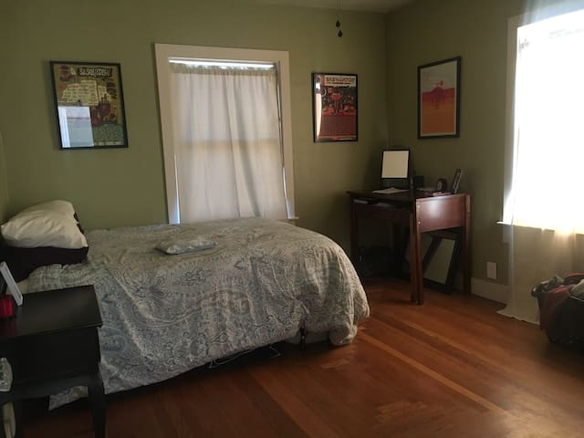 Furnished room in brick bungalow in midtown