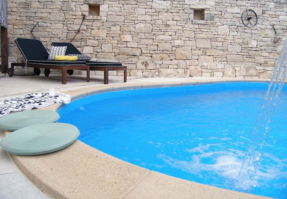 An outdoor swimming pool is available for a refreshment during hot summer days