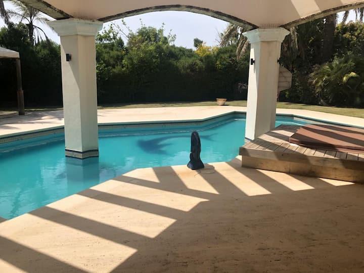 Spacious family villa in a calm and green area.