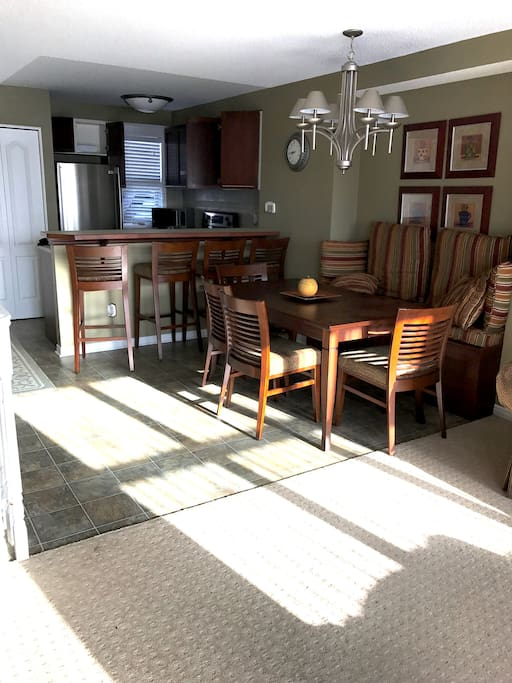 Family friendly dining area next to modern, fully equipped kitchen.