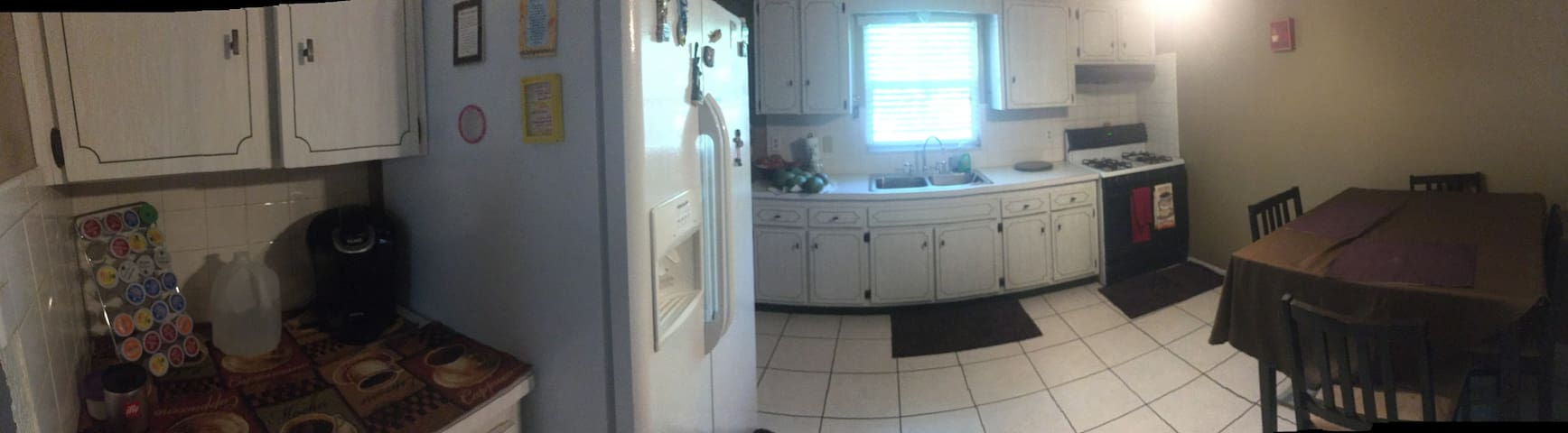 Kitchen area fully equipped, with a dining table & Keurig coffee available for guest.