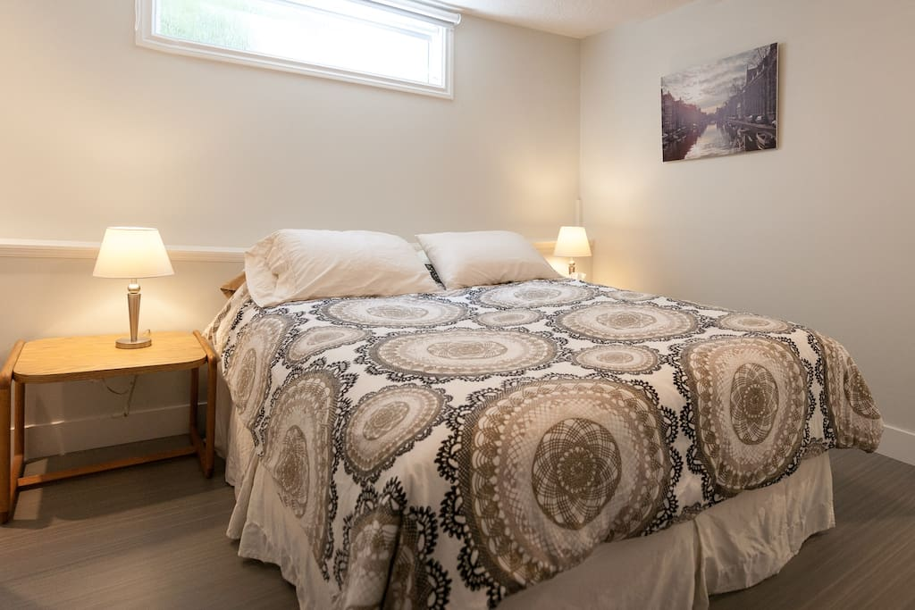 There is a comfortable queen sized bed and a large closet with plenty of space to keep your luggage organized.