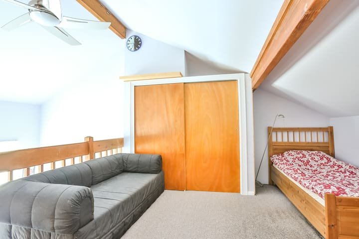 Third level (loft) with twin bed and convertible sofa bed.