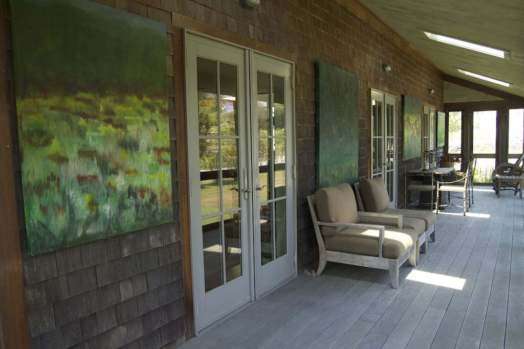 there r four french doors that lead to a wrap around porch for seating / dinning  ... south side of porch