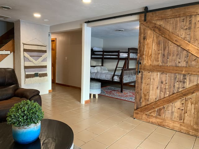 Lower Level provides another living area that opens to the backyard and lake. The sliding barn door is the entrance to the 4th bedroom. Kids will love it down here!