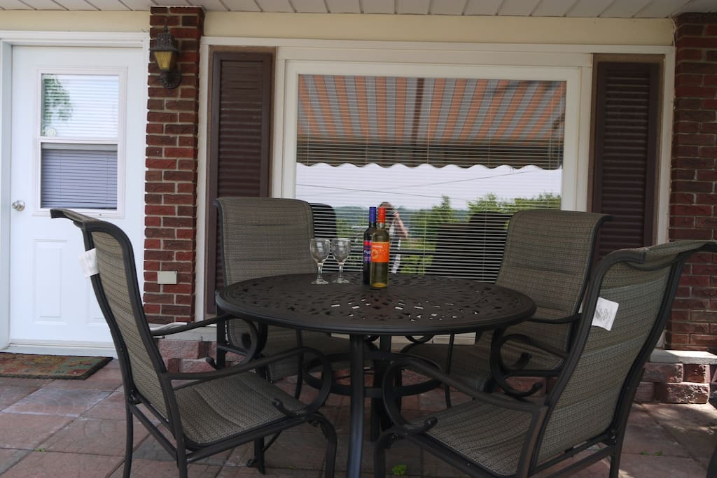 Enjoy a glass of County wine on the shady patio
