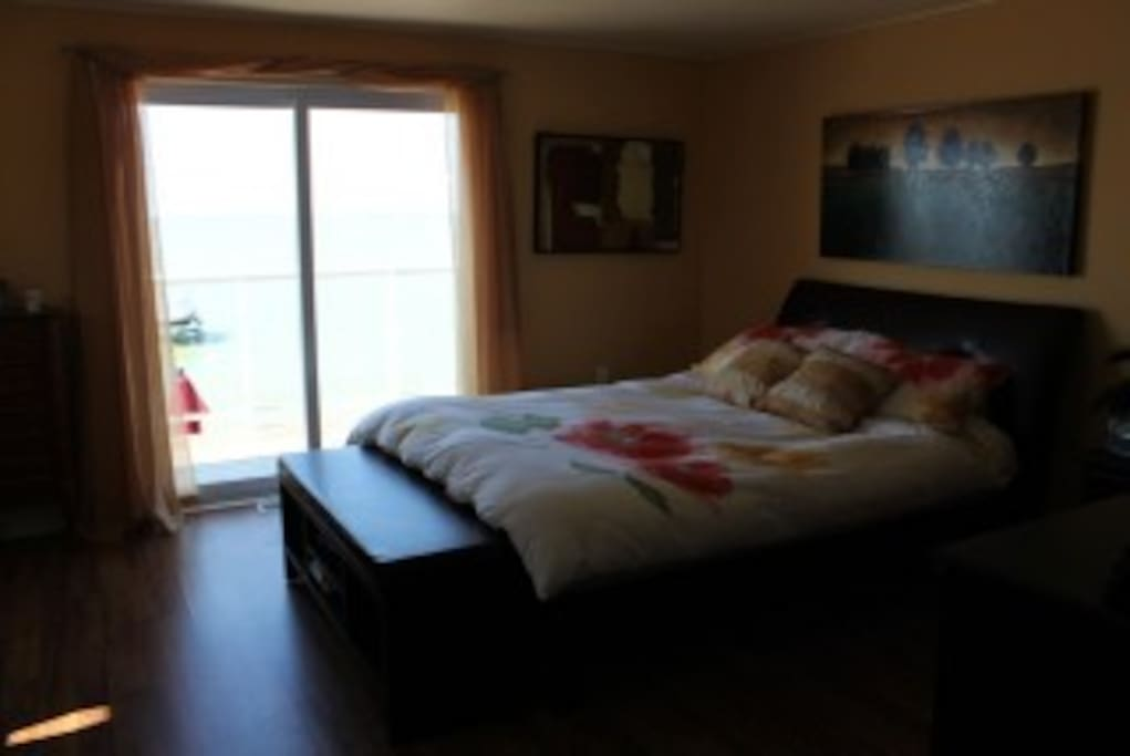 masterbedroom with walk out balcony