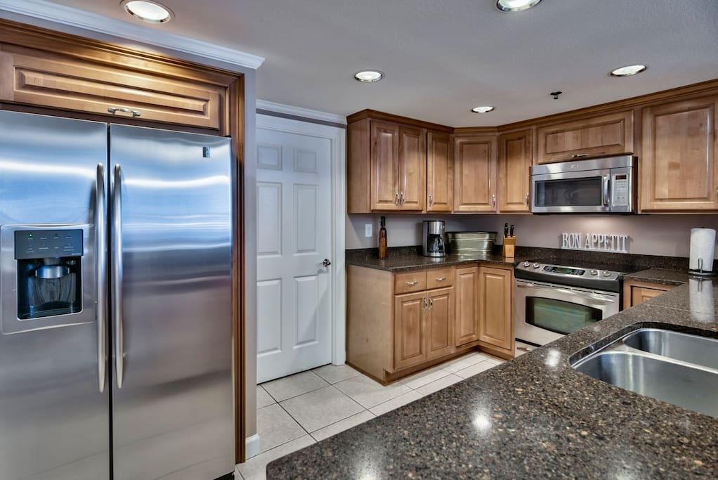 Additional View of Fully Equipped Kitchen With Breakfast Bar And Additional Seating