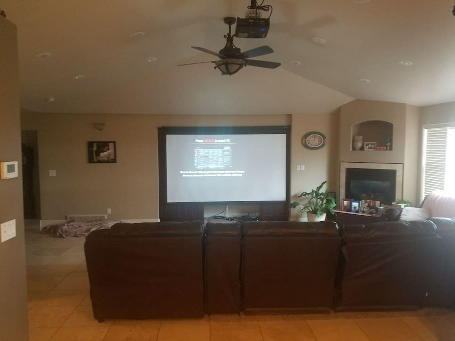 144 inch projector with surround sound for movies and entertainment and news Dish Network hooked up