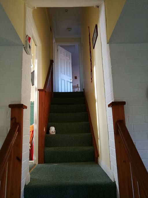 Rooms are at the top of the stairs.