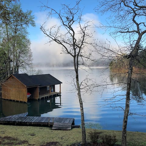 A beautiful morning sunrise view as the fog clears giving way to another wonderful day on the lake. (Boat house pictured is not part of property)