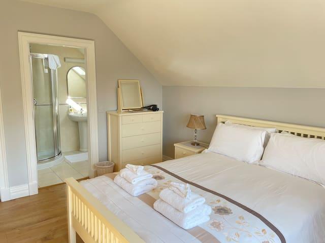 Bedroom is en-suite with shower. 5' ft Bed baby cot
