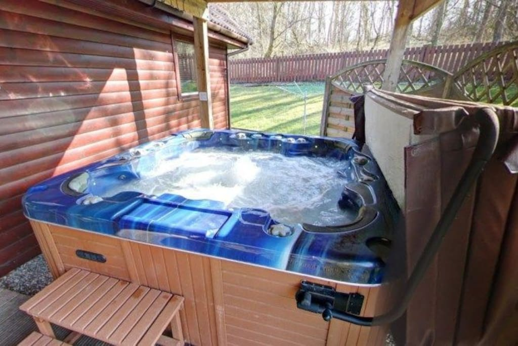 huge 7 seater hot tub with mood lighting, waterfalls etc