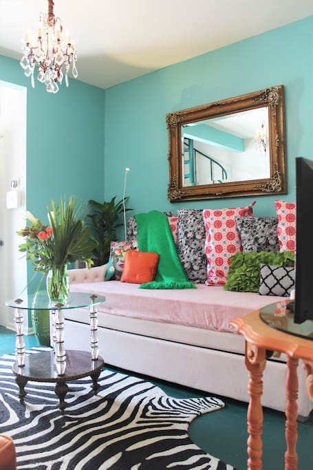Living room sofa doubles as a twin bed, with a second twin mattress in the trundle below!