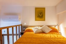 Double bed 130X200  on the loft, night stands with individual lighting