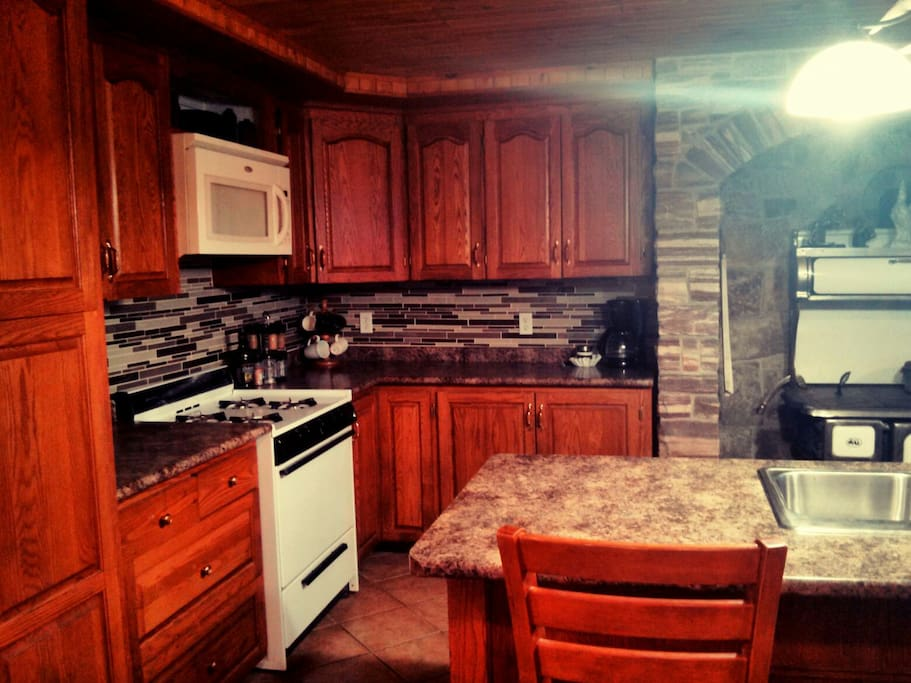 Kitchen with gas stove/oven.
