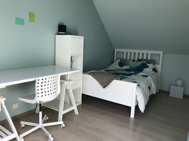Bedroom with two single beds and extra bed