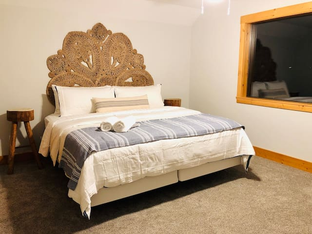 With a king bed and picture windows, you'll love waking up in this spacious master bedroom.