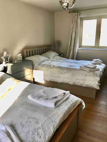 Bedroom 2 contains 2 double beds, a large wardrobe, 2 small bedside tables and 2 chest of drawers.  This room would suit children but would be a bit of a squash with 4 adults in. Please note there is only 1 bathroom in the property.