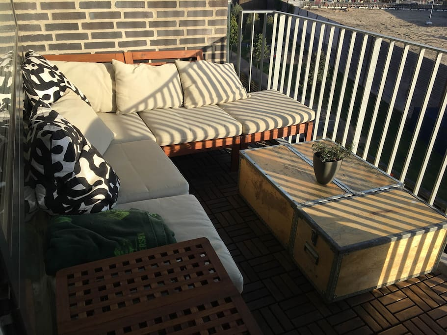 Balcony w seating for 5-6 persons and a monster BBQ