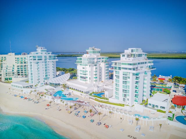 We are located on the beach in the famed Cancun Hotel Zone, kilometer 19.5.  Our resort name is Oleo Cancun Playa.  Pictured here you can see the closest tower on the rooftop is penthouse #3000.