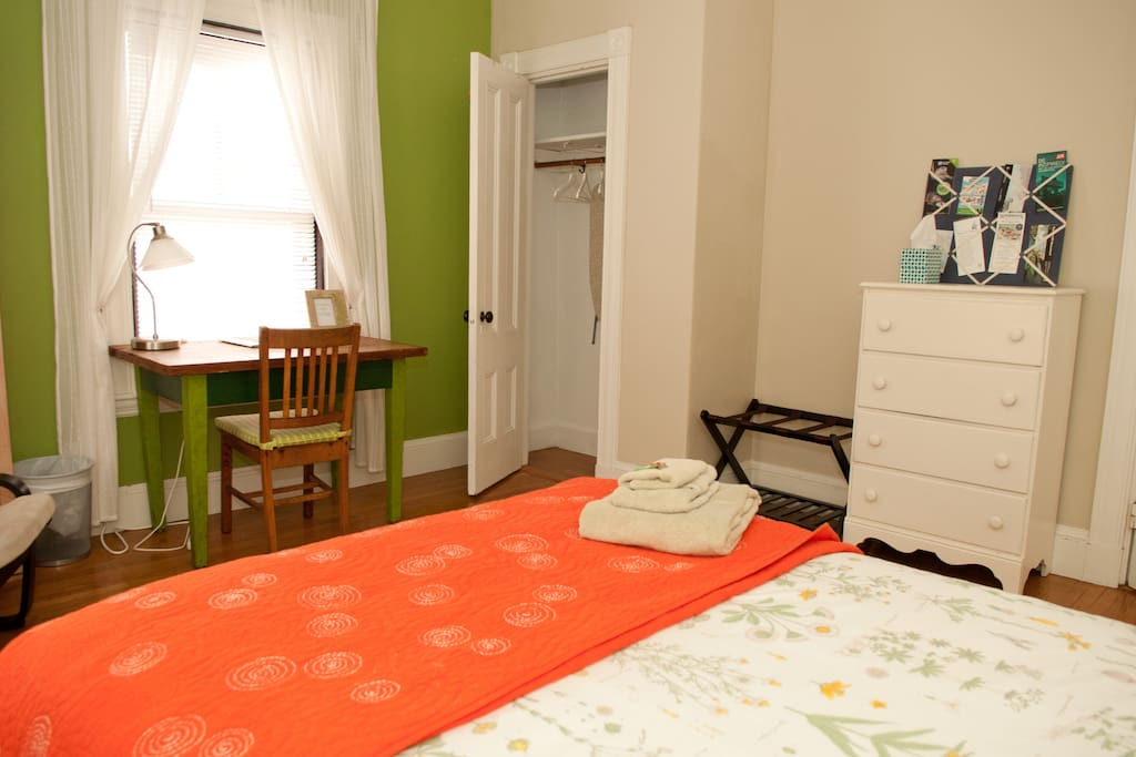 This is a large room with a full size double bed, fresh cotton sheets and blankets, a desk, a shelf, and a dresser for longer stays. There is also a closet.