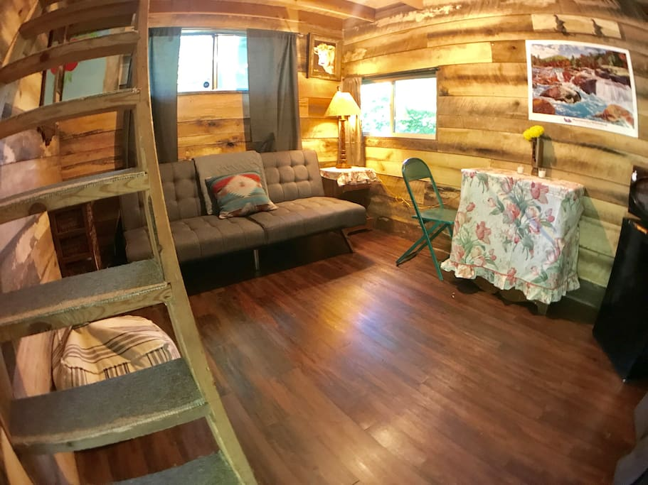 Eagle's Roost Bungalow #2 offers a two story cabin with a queen sleeping loft and pull out full size futon. It has a refrigerator and microwave. A full size kitchen and bathroom are located in the main lodge and available 24 hours a day.