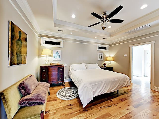 """The master bedroom has a king-size bed, a comfy sitting area, and a 48"""" TV."""