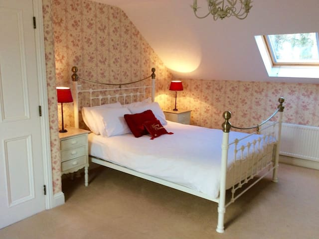 Upstairs bedroom with ensuite and walk in wardrobe area.