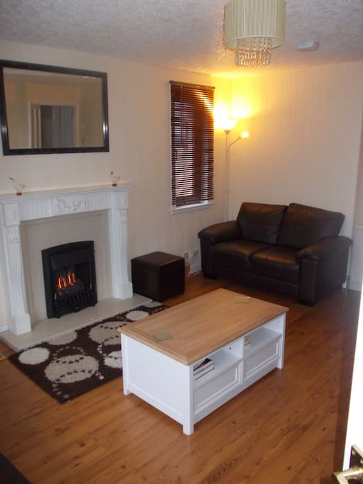 Large spacious living room with living flame gas fire. 3 Sofas.