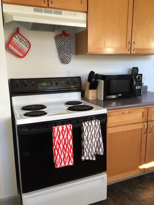 An electric stove, microwave oven and Keurig Coffee maker with coffee pods are available for your use.