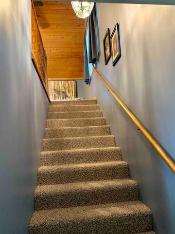 Upstairs above the garage, private room with entertainment center, tv, large sectional couch and two twin size beds. Air conditioner. two ceiling fans. Baby crib.