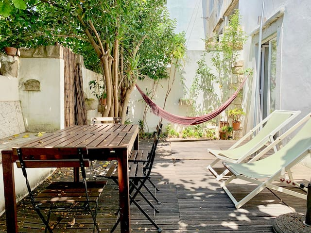 Village Apartment with Quiet Backyard in Town