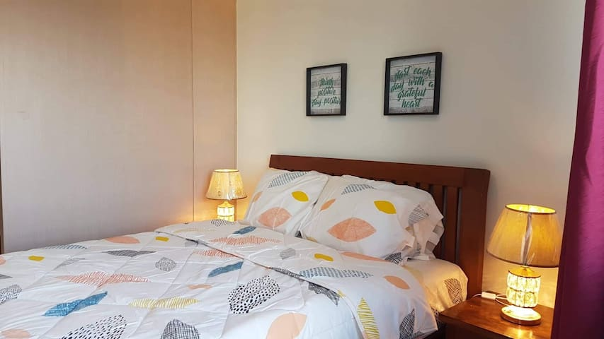 Bedroom- A queensize bed with two side table and two night lamps to make you comfortable in your sleep.