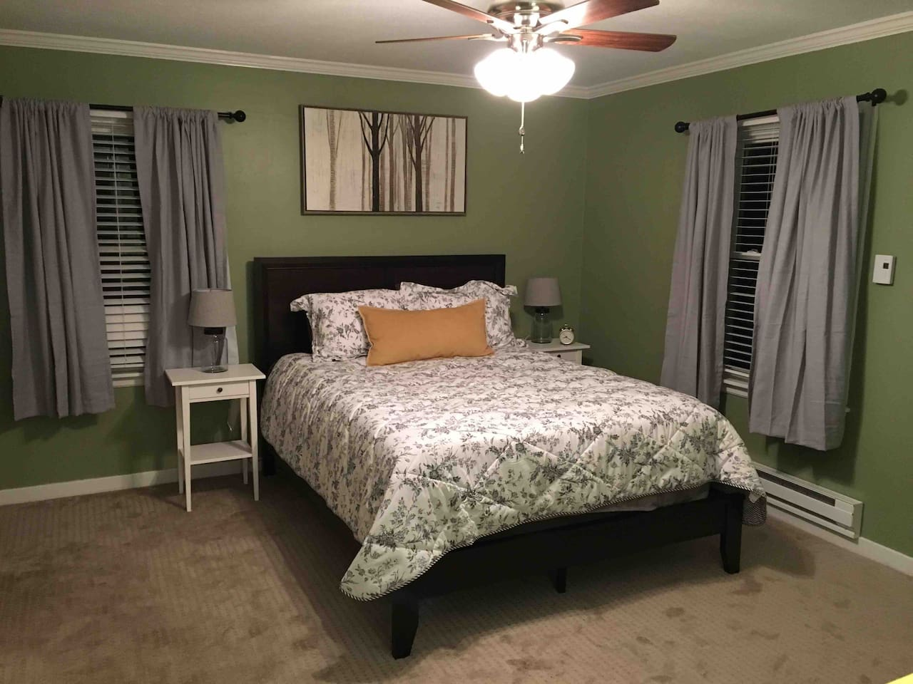 Queen bed in a spacious bedroom.