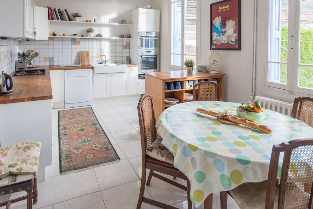 Big, spacious kitchen with dining table that extends to seat 8 people