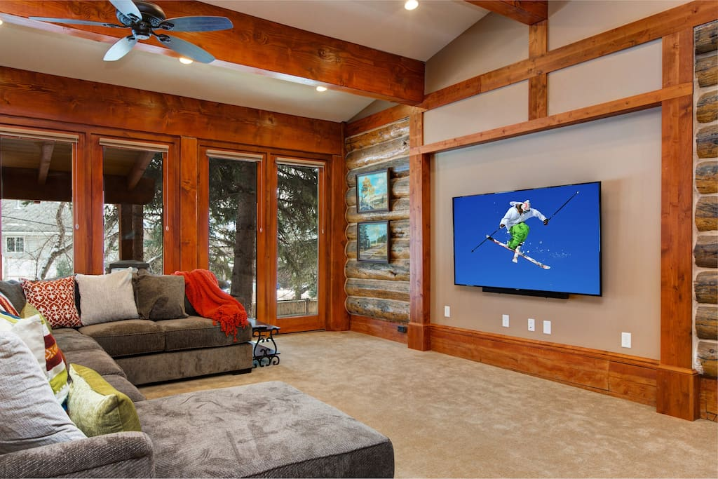The ultimate movie night: Wood beams, glass doors, and a 80-inch flatscreen TV!