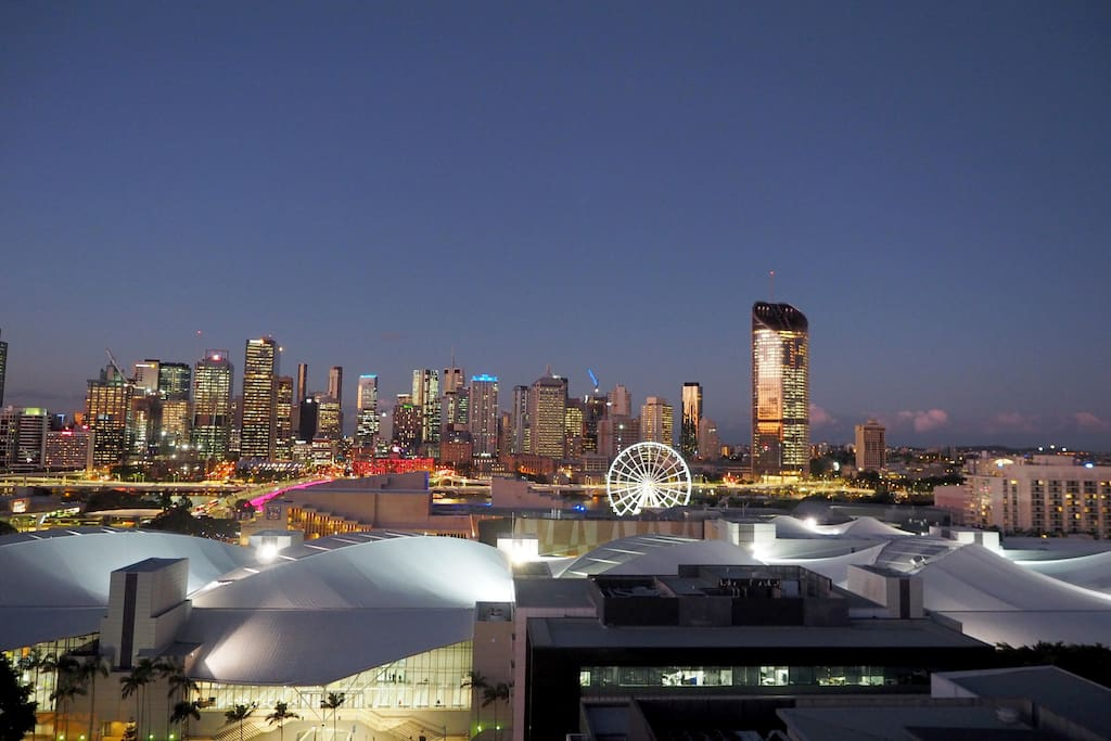 The rooftop view of the city with the Brisbane Convention and Exhibition Centre in the foreground.