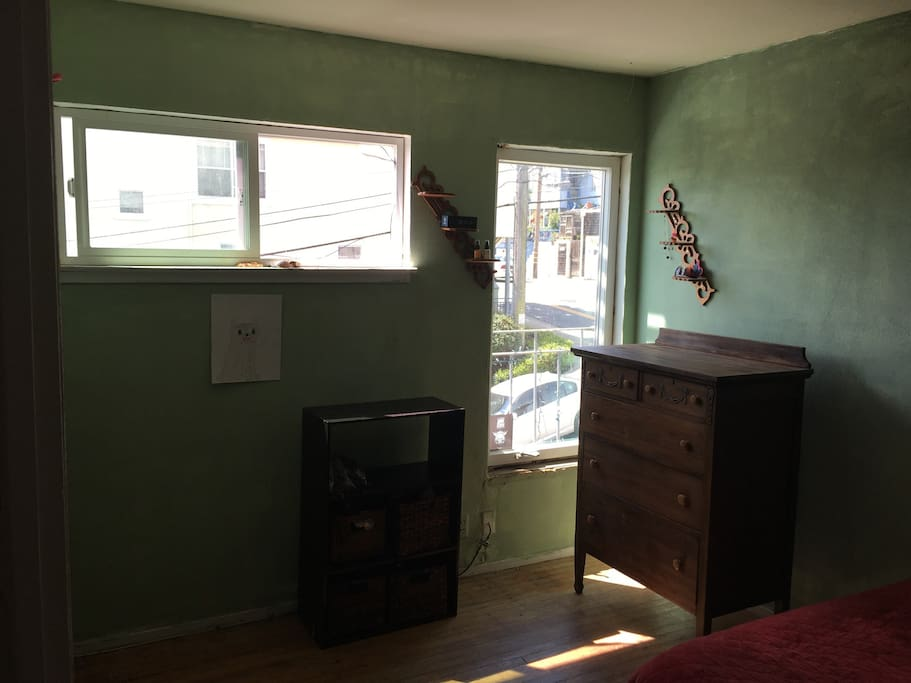 The room is rustic, old wood floors and unfinished window frames.  Full-sized bed.