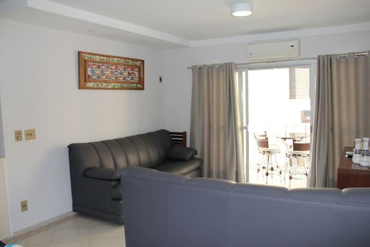 Sala com 2 sofás-cama