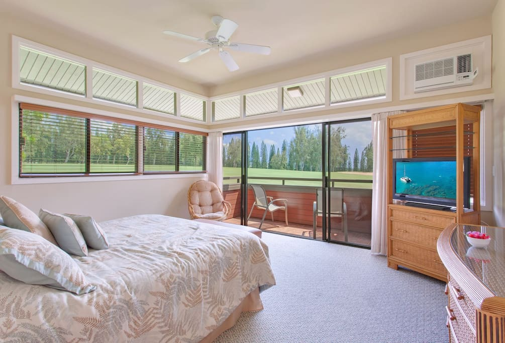 The master bedroom features fabulous views and a private lanai
